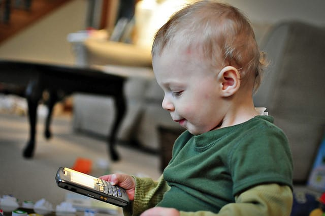 Baby checking email on his phone